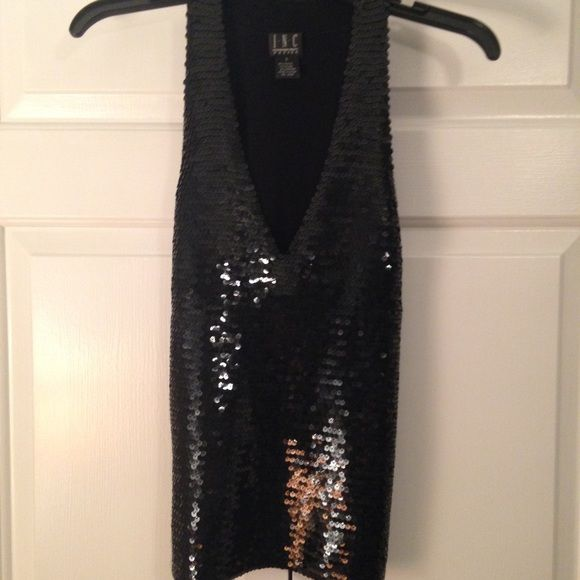 INC Black Sequin Racerback Top Sexy deep v-neck sequin front. The racerback has stretch and is really comfortable. I love this top but never get a chance to wear it. It's in great condition - I checked thoroughly and don't see any sequins missing or damaged. Size small petite. INC International Concepts Tops