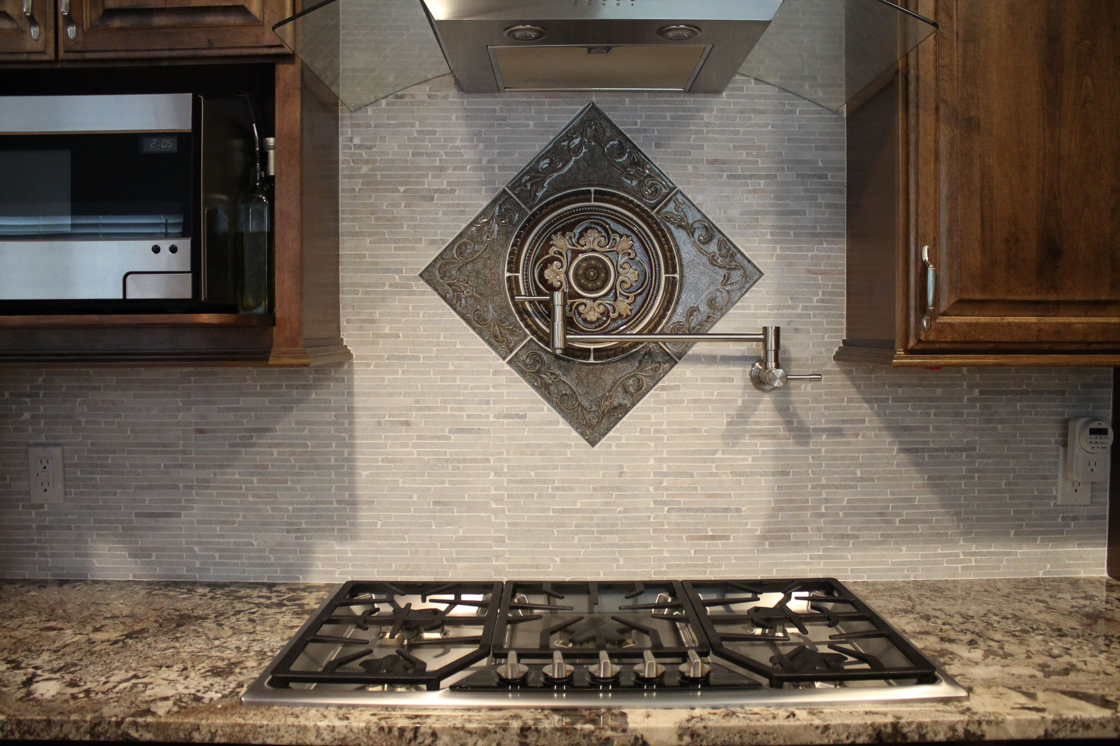 #Kitchen Backsplash Design With Gray Brick #tile Mosaic And Sonoma Bronze  Medallion Accent.