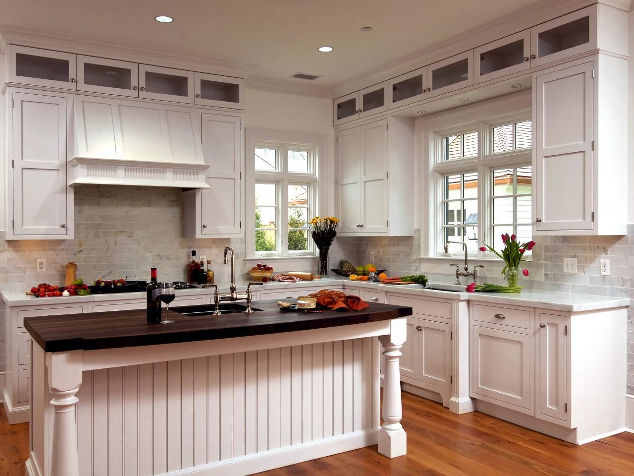 This Airy Kitchen Boasts White Cabinetry A White Range