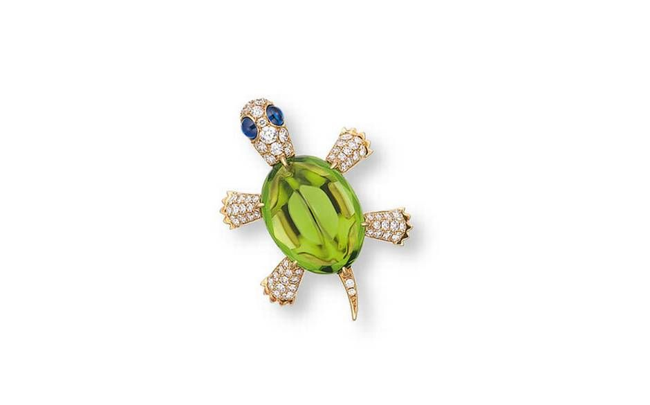 A peridot, diamond and sapphire pin in the design of a Turtle, by Gimel