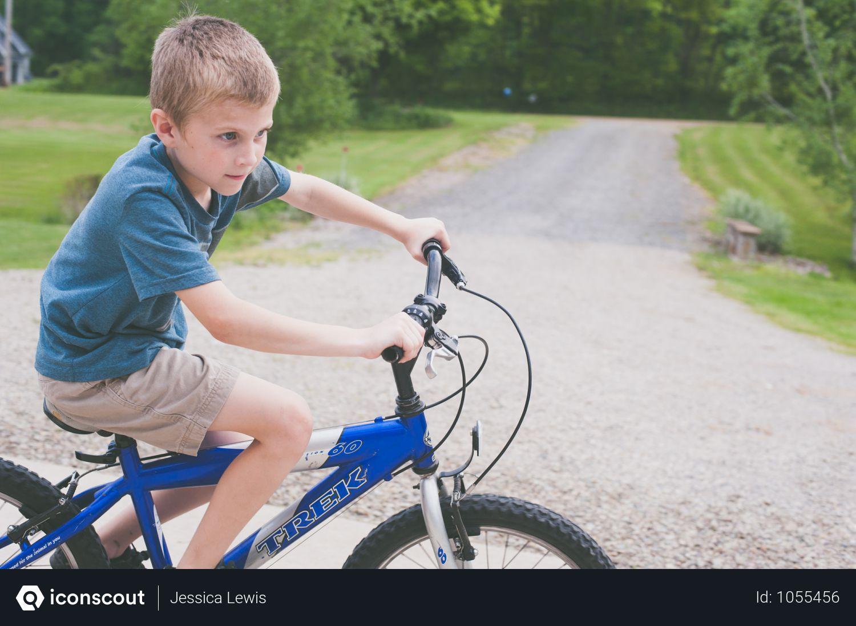 Free Boy Rides Blue Trek Bike At Daytime Photo Download In Png Jpg Format Trek Bikes Bike Bicycle