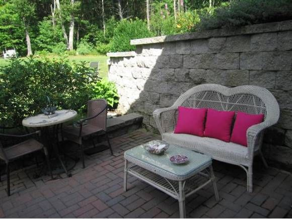 Comfy and bright outdoor hang out space. Love the pink ...