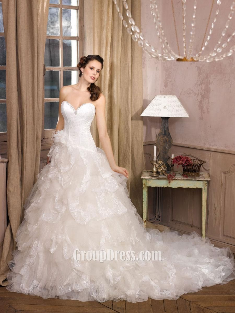 Strapless Satin Wedding Gown With Dramatic Ruffle Tulle Skirt