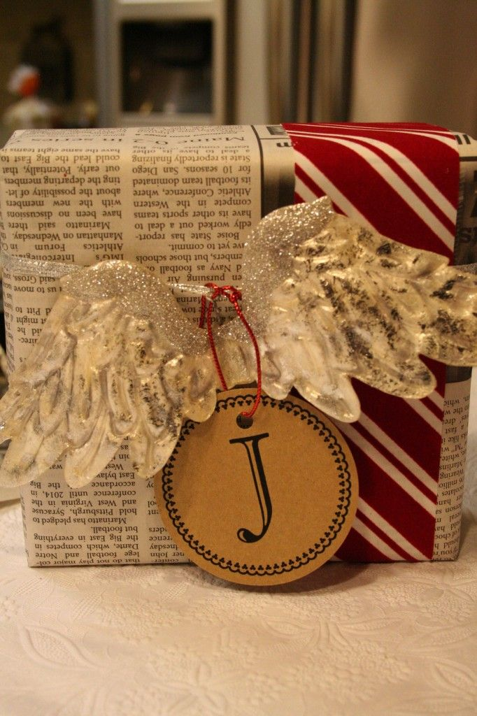 What a cute idea - just use newspaper for gift wrap, then fancy it up with a great ribbon, a cheap ornament and a little gift tag you can make yourself!!