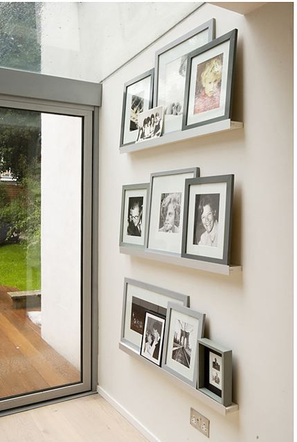 love these photo shelves and the tones of grey
