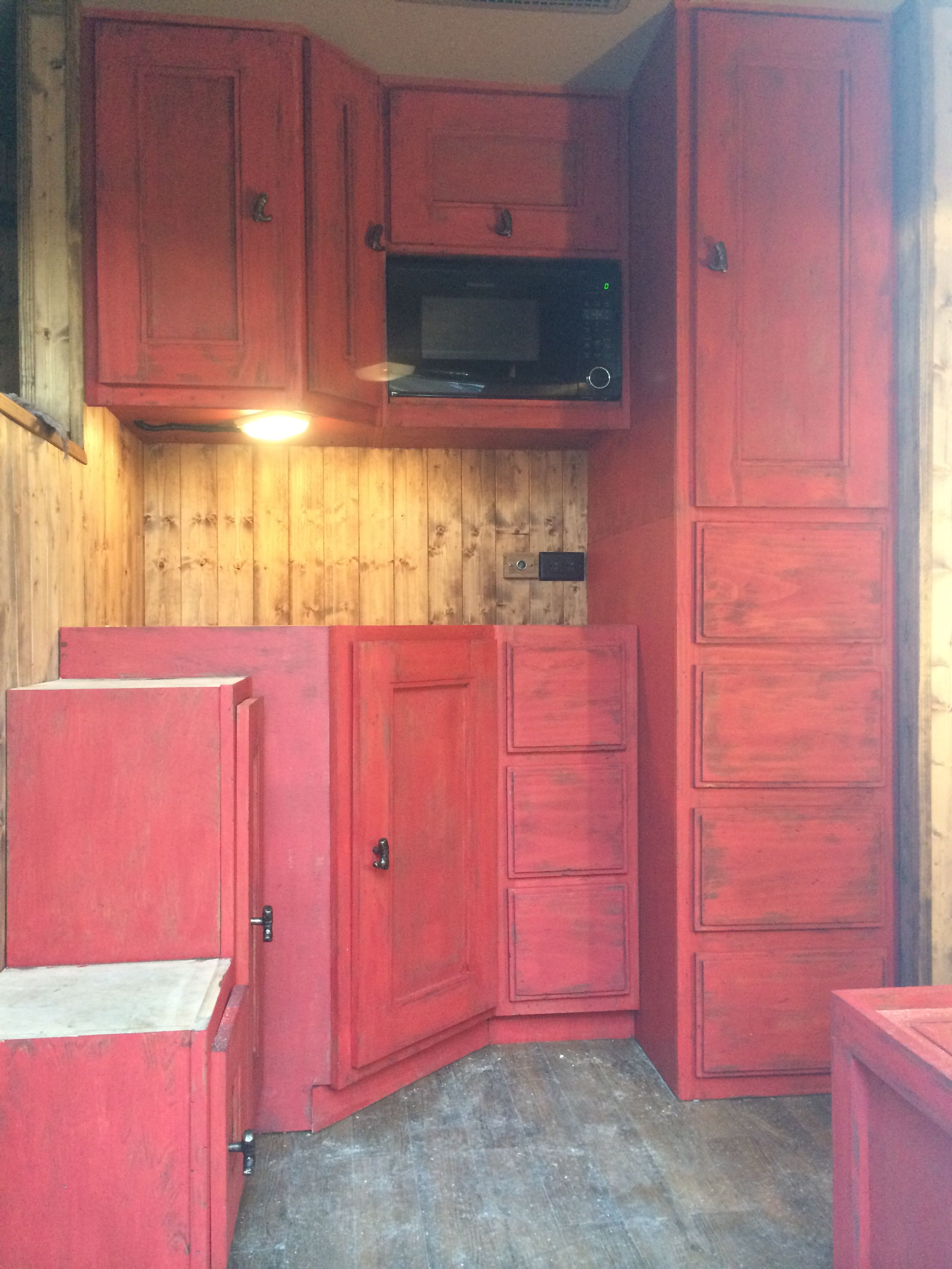 Almost done! Red distressed cabinets. Labor of love ...
