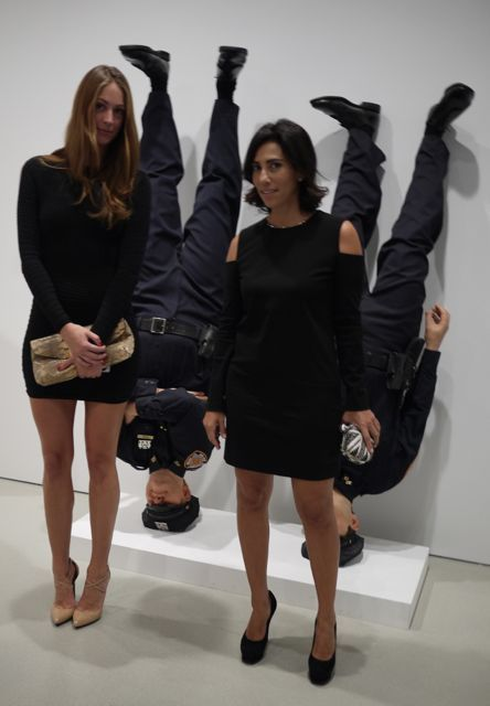 Maurizio Cattelan police officers checking out my Lanvin dress, YSL shoes, and Alexander McQueen bag.