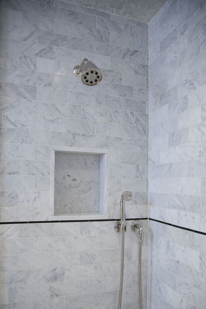a custom carrara shower niche was created for u201d slab and inset into the wall