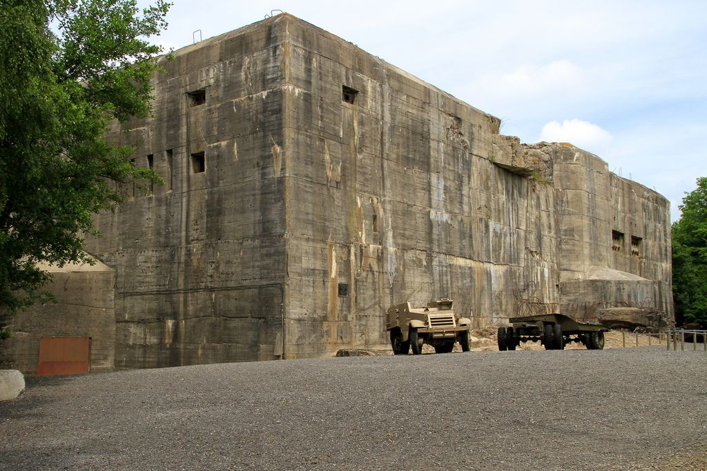 "1943- The Blockhaus d'Eperlecques is built using slave labor in northeast France for the Nazis as a launching facility for ballistic missiles against London. The ""Wunderwaffe"" V-2 ballistic missile intended for use here requires large fuel supplies of liquid oxygen which is intended to be stored at the site. The style of bunker is based on the massive submarine pens being built by the Germans in France & Norway, & is designed to launch 36 ballistic missiles a day."