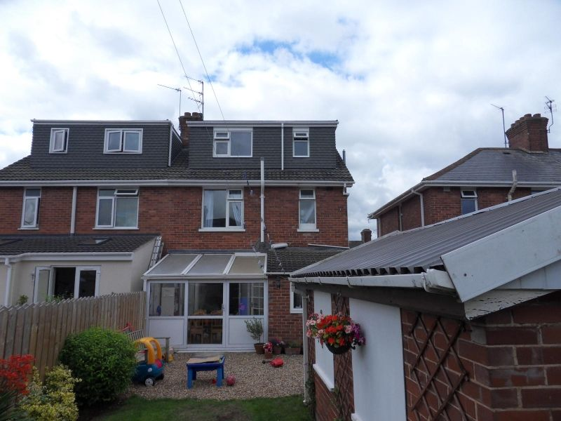1930′s Semi Detached House hip to brick gable with flat