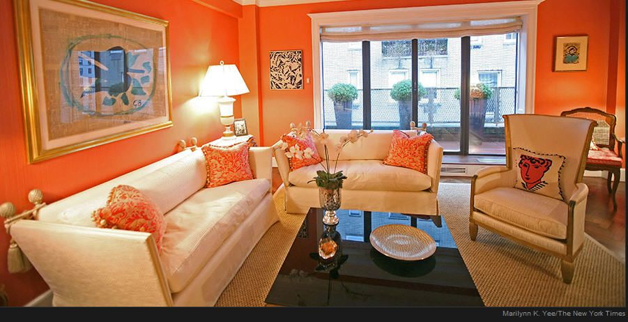 Orange Living Room Decorating Trend | Orange walls, Chair pillow ...