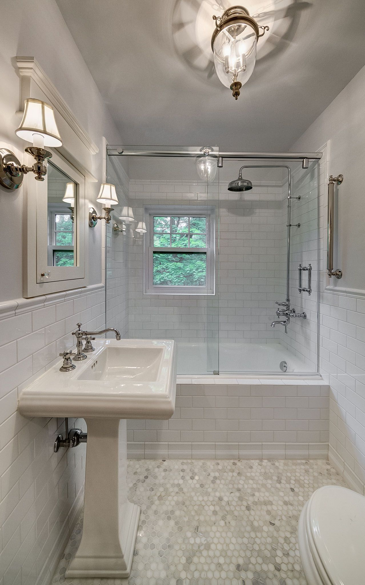 Guest Bathroom Featuring White Subway Tile And A Hexagon Mosaic