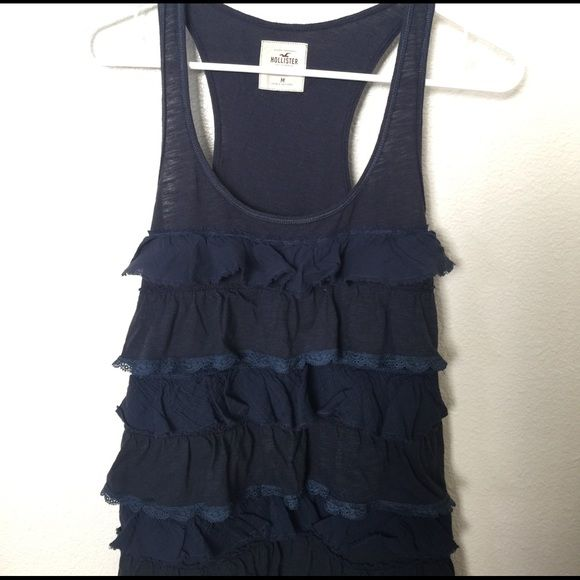 🌺 Hollister Tank Top Navy blue racer-back tank top. Ruffled front. Plain back. Normal length. Hollister Tops Tank Tops