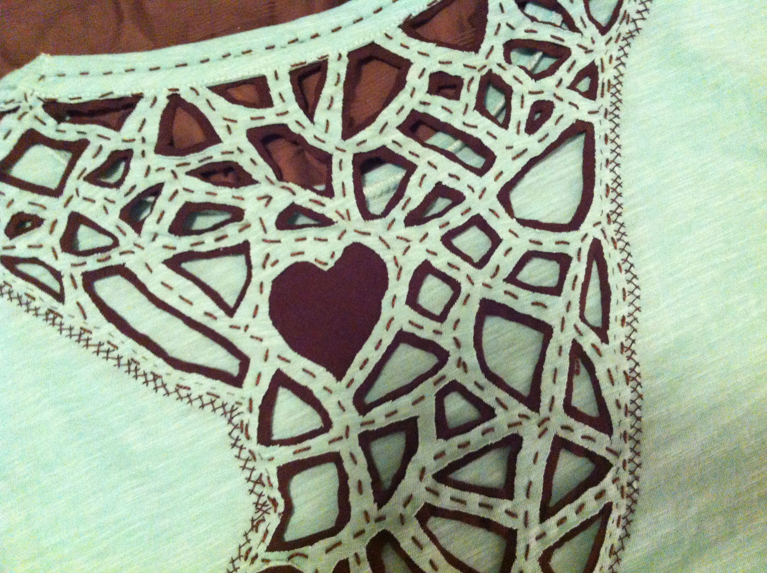 Converted cheap $5 T-shirt into a pc of art with cutwork / applique/ and embellishments!