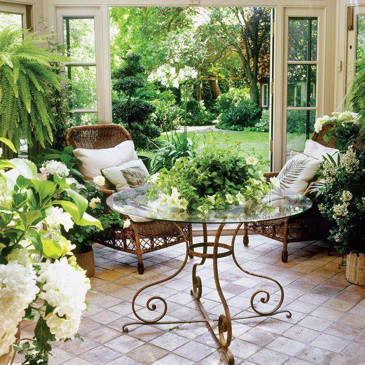 Gorgeous garden room.....love the tile floor, french doors ...