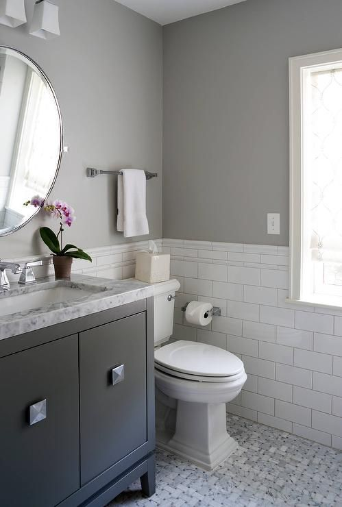 charming white and gray bathroom features floors clad in marble basketweave tiles large white subway backsplash tiles lined with marble pencil