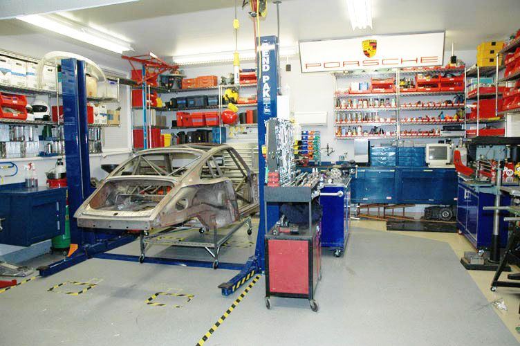 Best use of a 2 car garage ever garage workshop for Home mechanic garage layout ideas