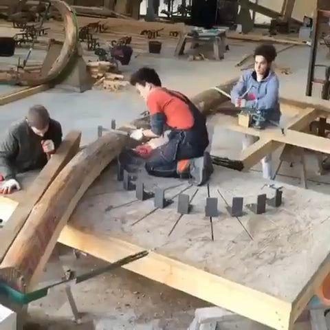 Bending a wooden log