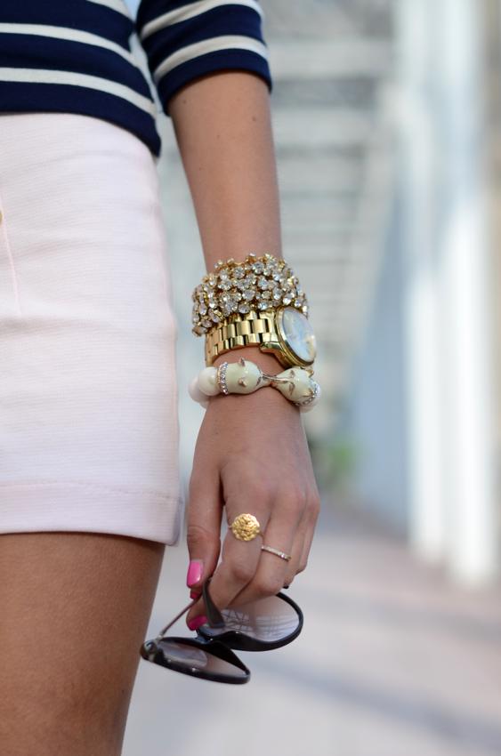 stripes. gold watch. stacked bracelets.
