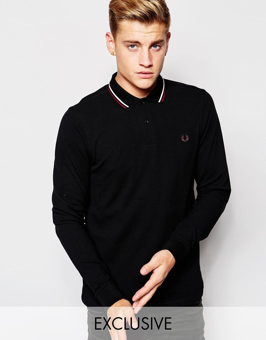 "Polo shirt by Fred Perry Breathable cotton pique Ribbed collar and cuffs Signature twin tipping detail Embroidered logo Two button placket Regular fit - fits true to size Machine wash 100% Cotton Our model wears a size Medium and is 185.5cm/6'1"" tall Exclusive to ASOS"