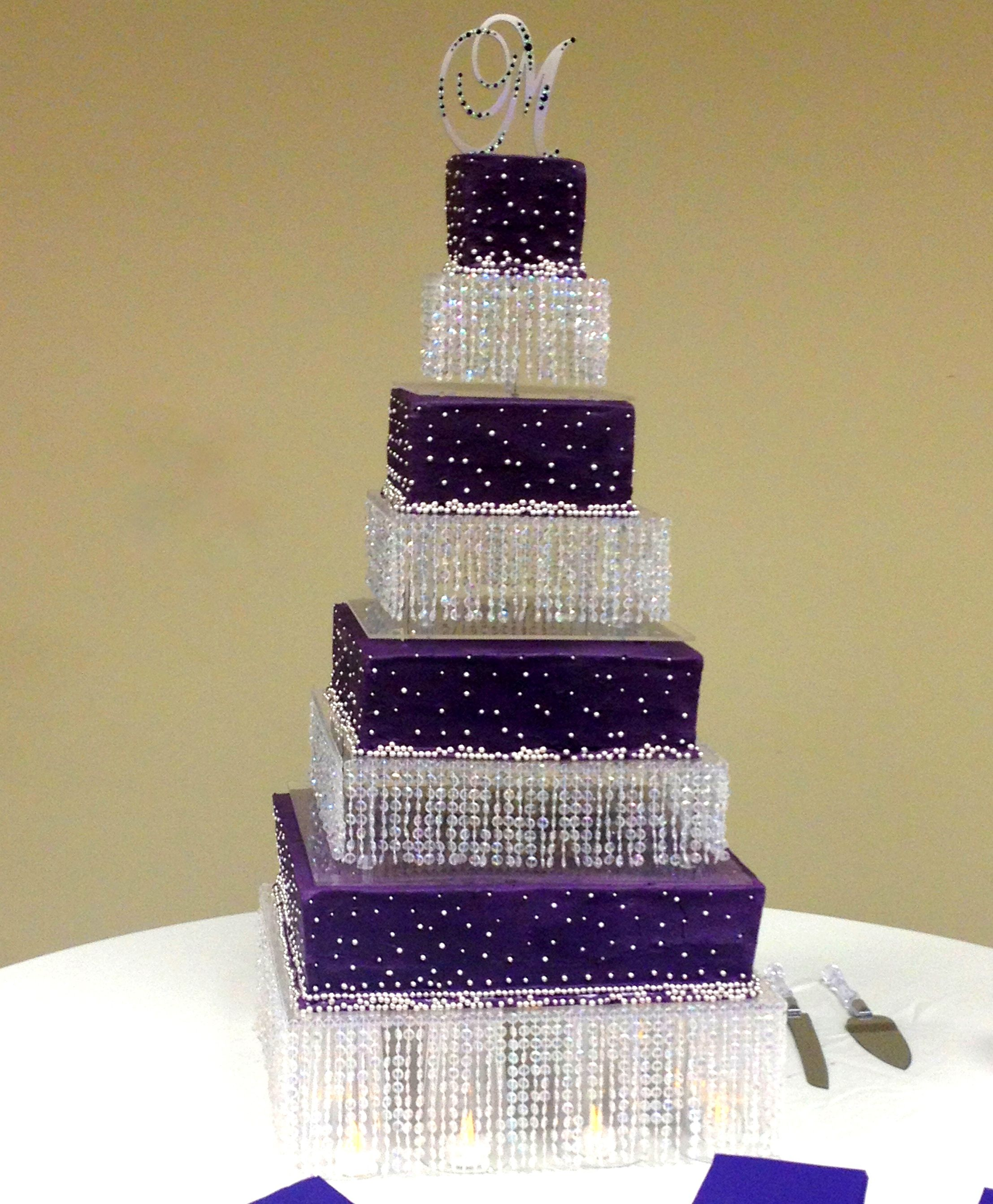 Fabulous bling wedding cake in a deep eggplant purple with
