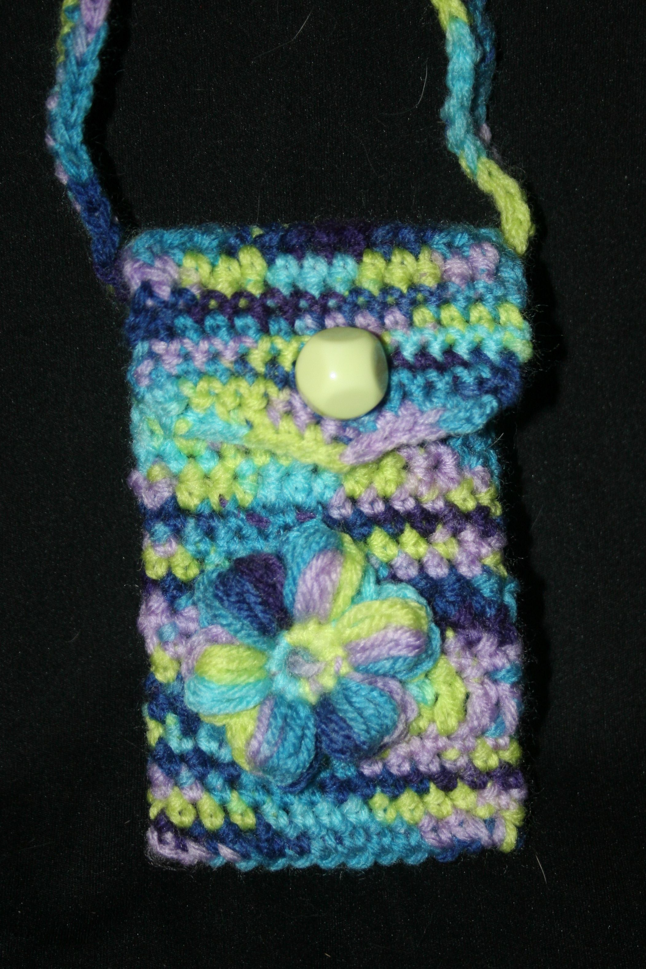 Cute little crochet bag to carry your cell phone    Yarn: Craft Smart Giverny