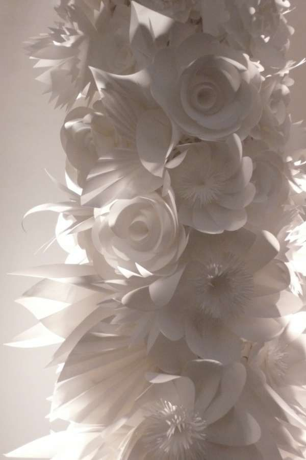 White paper flowers designed by Karl Lagerfeld at the runway show for his all-white Chanel collection.