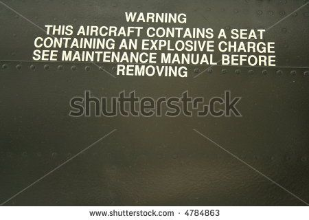 ejection seat warning on side of a jet - stock photo