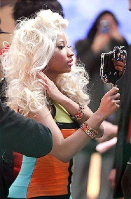 Nicki Minaj holding a Hello Kitty mirror