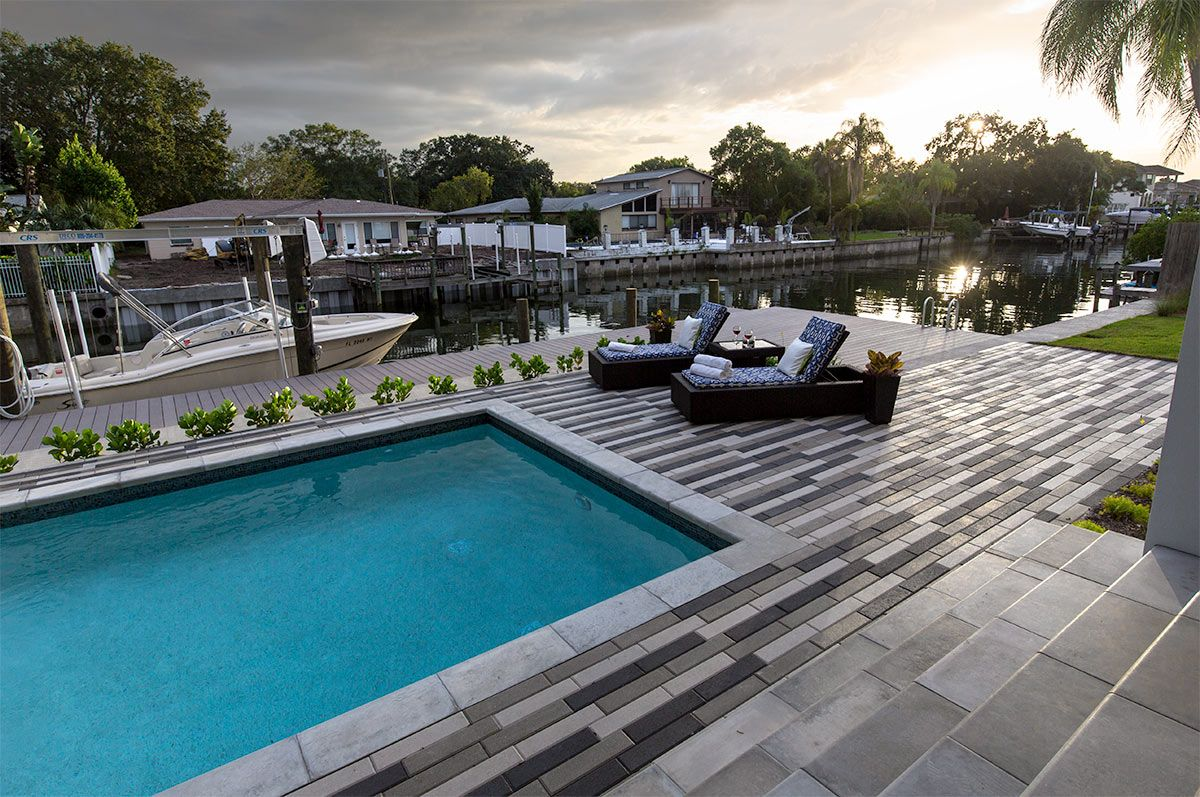 Plank Pool Deck : Create a sleek and modern pool deck by combining multiple