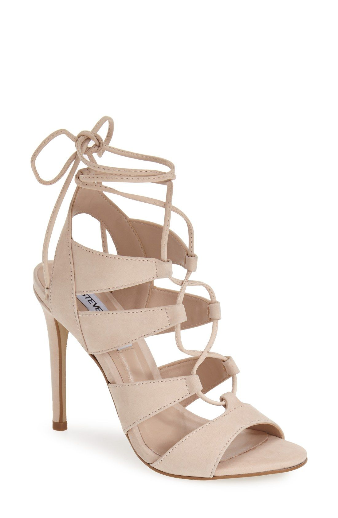 646c184b25e0d1 Crisscrossed laces corset the straps of this chic sandal lifted by a  stiletto heel in a gorgeous blush color.