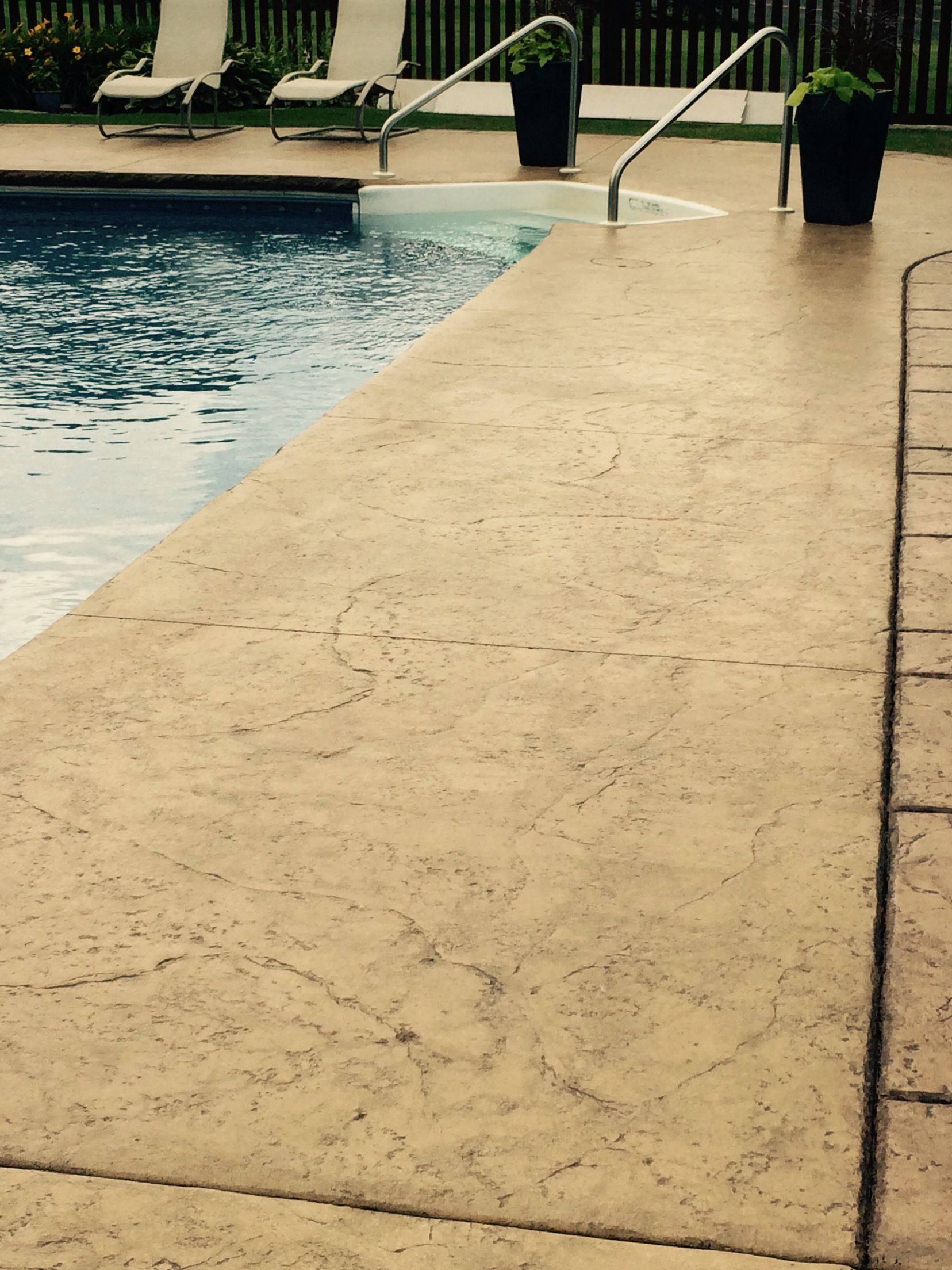 Stamped and colored concrete pool deck with custom chiseled stone ...