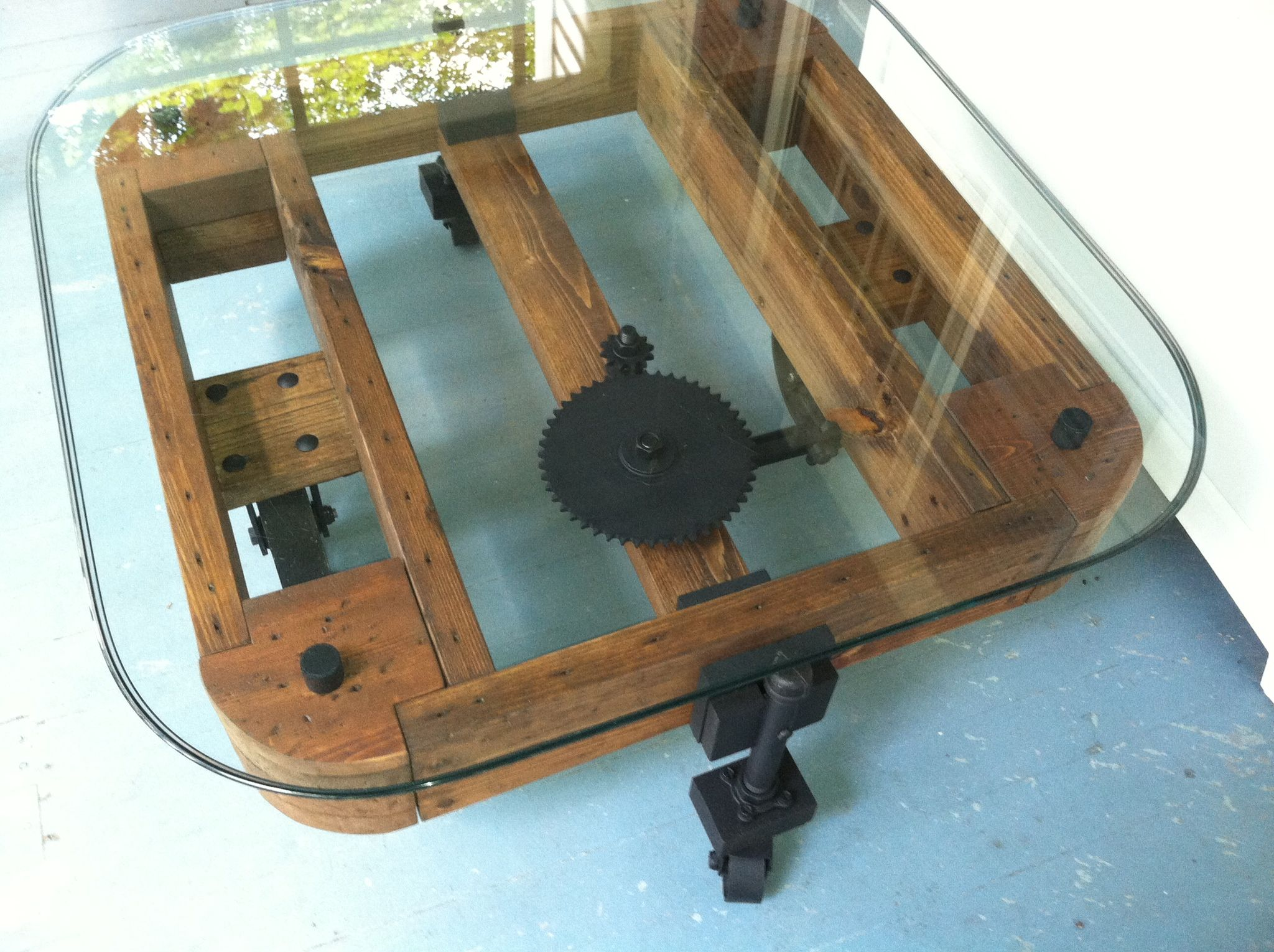 glass table top view. Top View Of Industrial Coffee Table With Glass Top. I Love The Gears. Repurposed He Also Used Leftover Wood From A Construction Site!