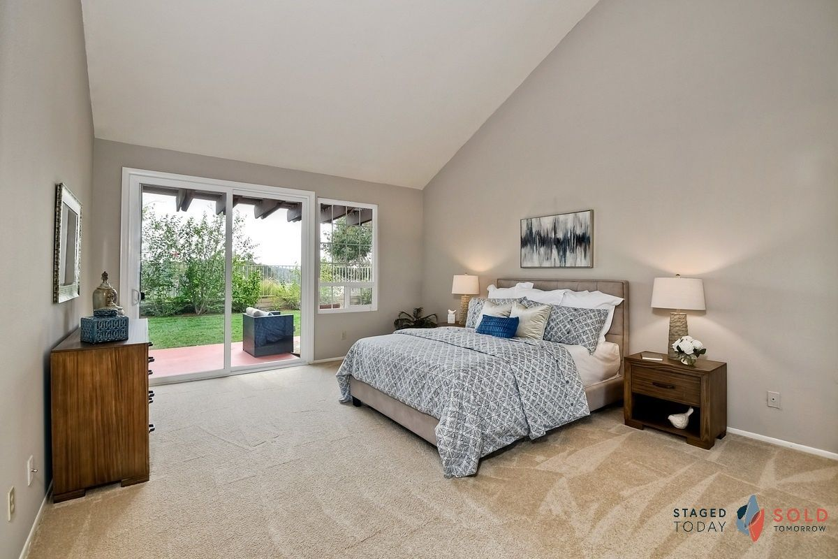 This Master Bedroom Feels So Much Larger With The Sliding Glass Doors And Access To A Private Outdoor Space Masterbedroom Home Staging Home 3 Bedroom House