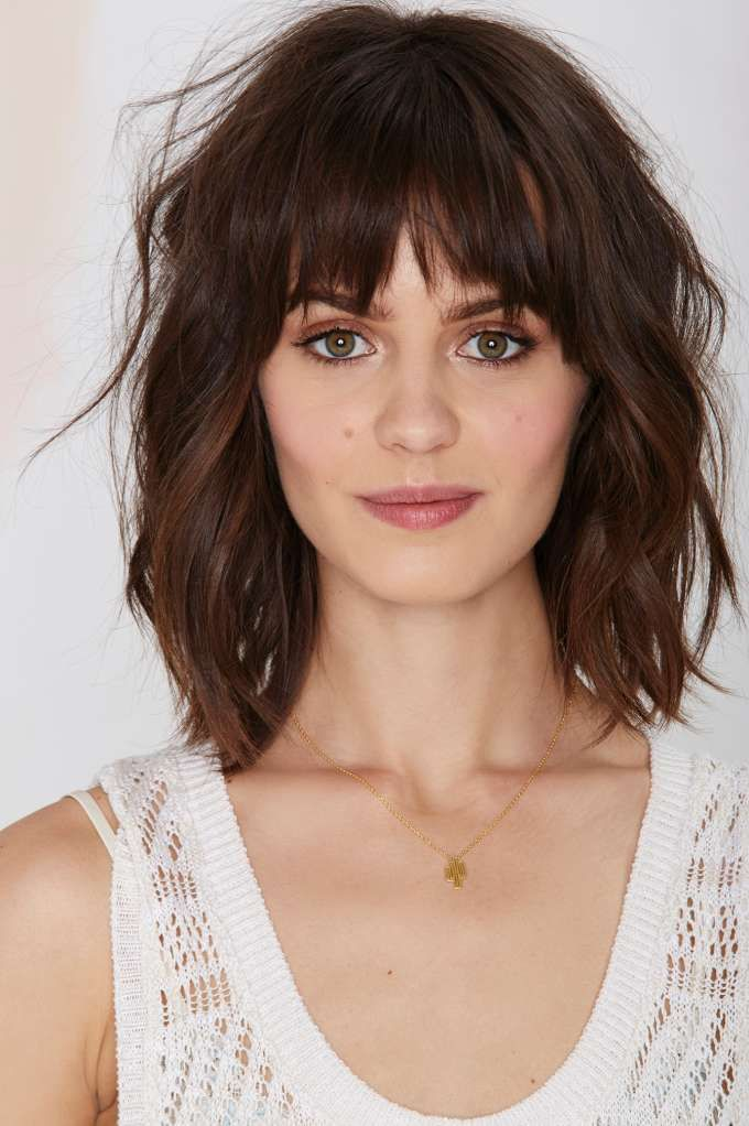 Textured Shoulder Length Haircut With Bangs