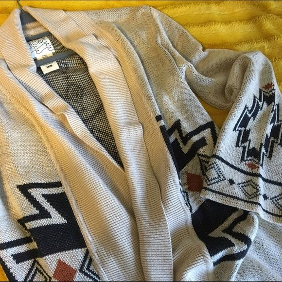 Billabong Aztec print knit cardigan Cool and cozy with slightly belled sleeves for comfort. Light snagging near the pocket but not very noticeable. Billabong Sweaters