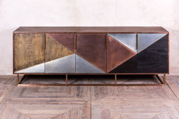 Bring some 1920s luxury into your home or business with this Art Deco style sideboard.  A real eye-catcher, this large piece has a striking zinc, ebony, copper and reclaimed timber front, with a walnut top. #sideboard #artdecostyle #cupboard #stylish #peppermillinteriors #burntwood #staffordshire #westmidlands