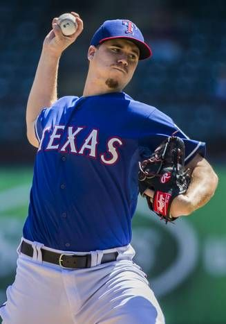 Texas Rangers starting pitcher Alex Gonzalez (72) pitches during the fifth inning of their exhibition game against the New York Mets on Saturday, April 4, 2015 at Globe Life Park in Arlington, Texas. (Ashley Landis/The Dallas Morning News)