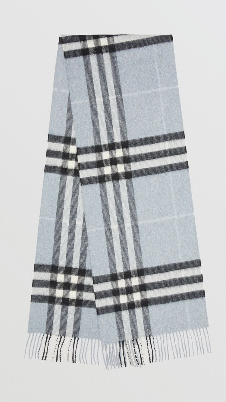 395477fff25e1 The Classic Cashmere Scarf in check is made at a 200-year-old mill in the  Scottish countryside.
