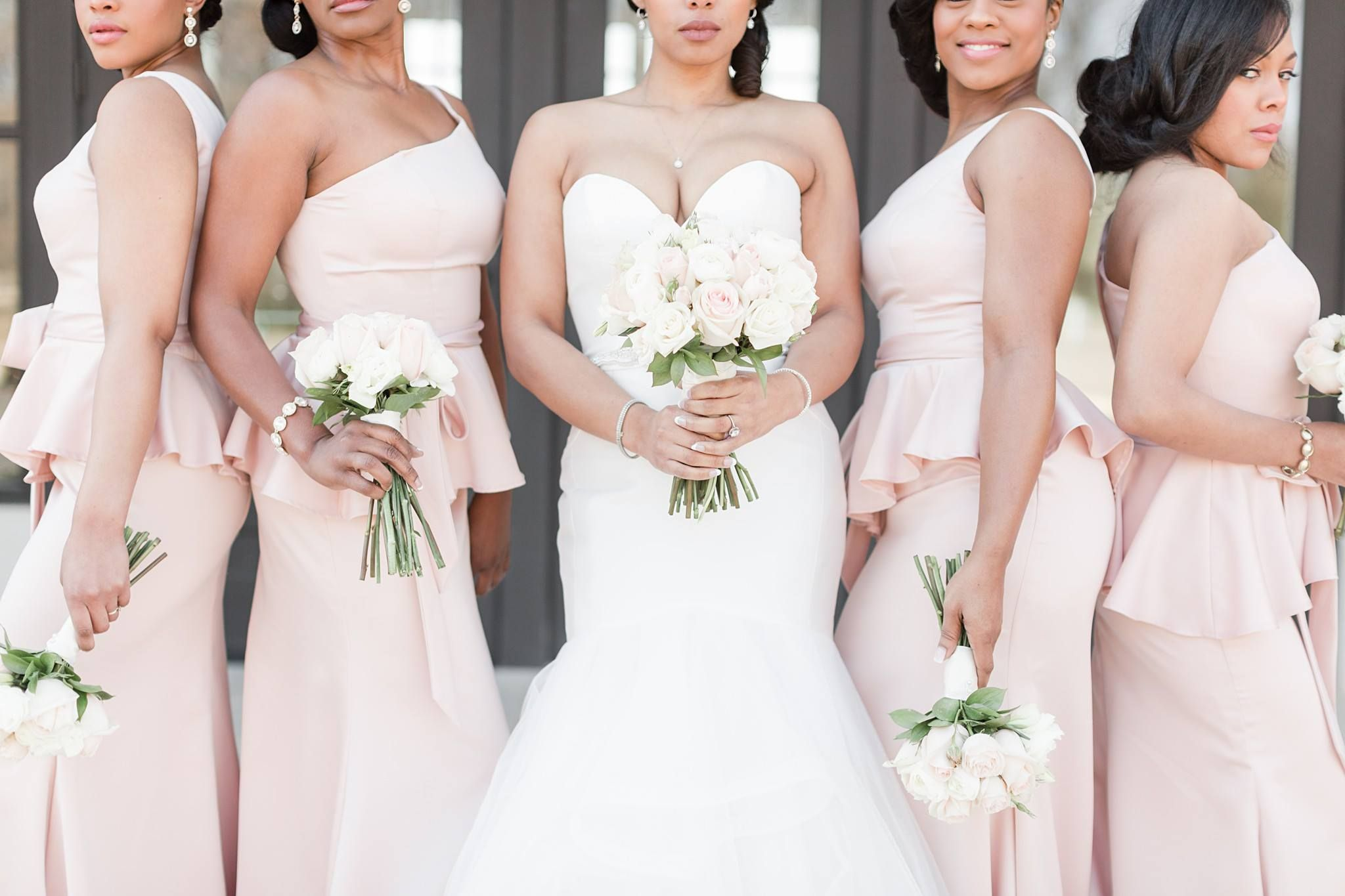 Just....slay. These incredible women look flawless and those bouquets bring us nothing but smiles! Photo credit: Amy Hutchinson photography