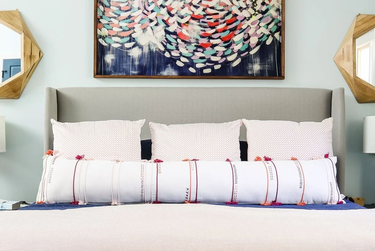 Creating a long DIY bolster pillow is easy with this tutorial! With a few easy steps make a beautiful long bolster that costs a fraction of buying one.