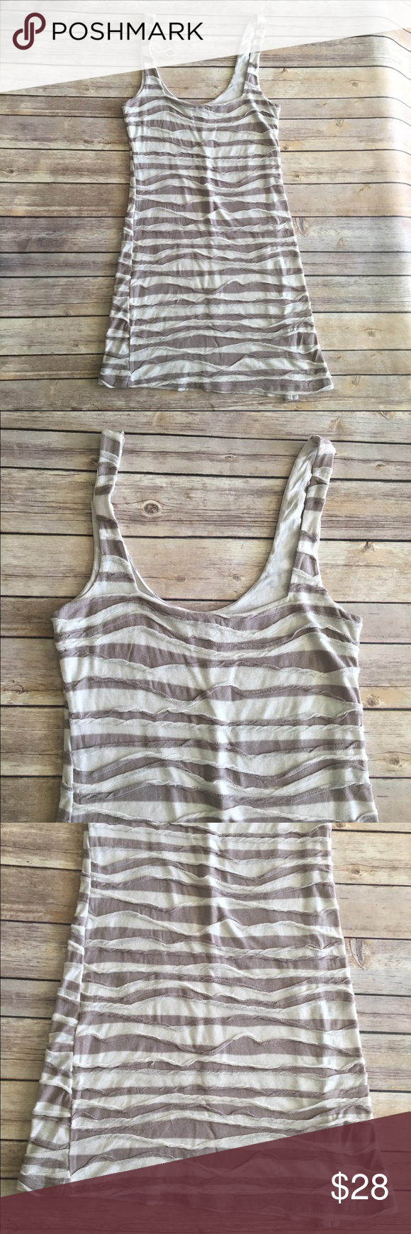 Free people gray and cream body con dress Gray and cream textured stripe dress by Free People. Good condition. Measures about 32 inches around the bust, about 29 inches around the waist and is about 34 inches long. Free People Dresses