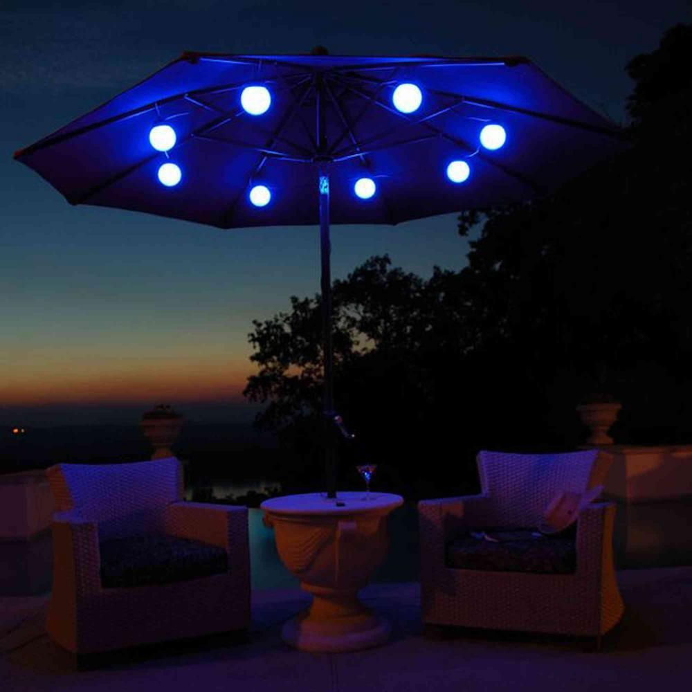 Superb Enjoy A Peaceful And Romantic Night With Solar Lights Gathered By Patio  Umbrella At Daytime.
