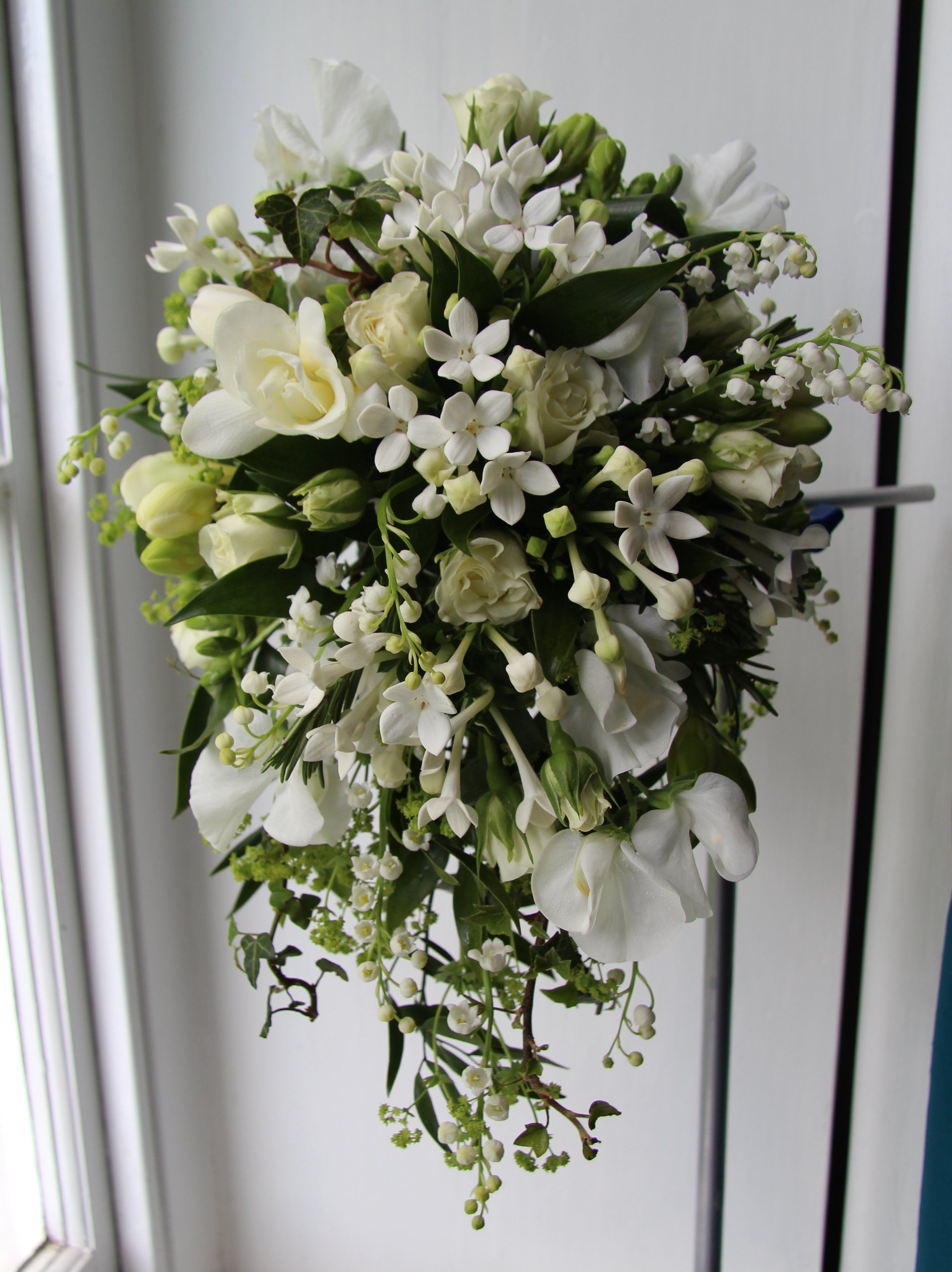 Stunning ivory wedding bouquet of lily of the valley
