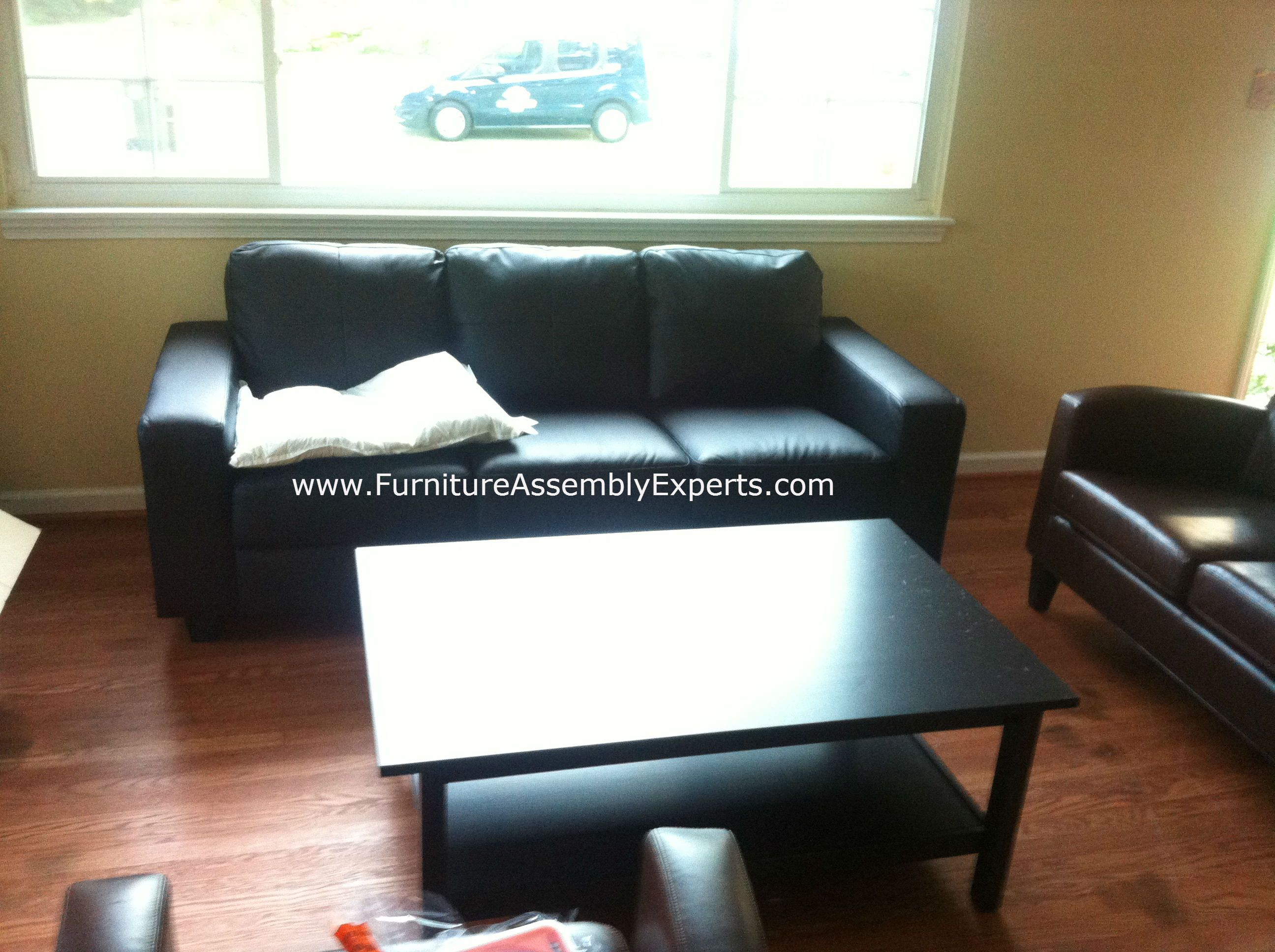 leather sofa washington dc interiors studio city ikea skogaby and lack coffee table assembled
