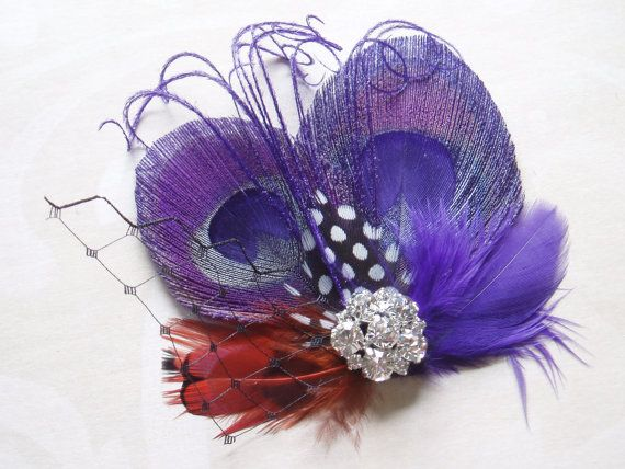 Hey, I found this really awesome Etsy listing at https://www.etsy.com/listing/107768426/purple-peacock-feather-hair-clip-wedding