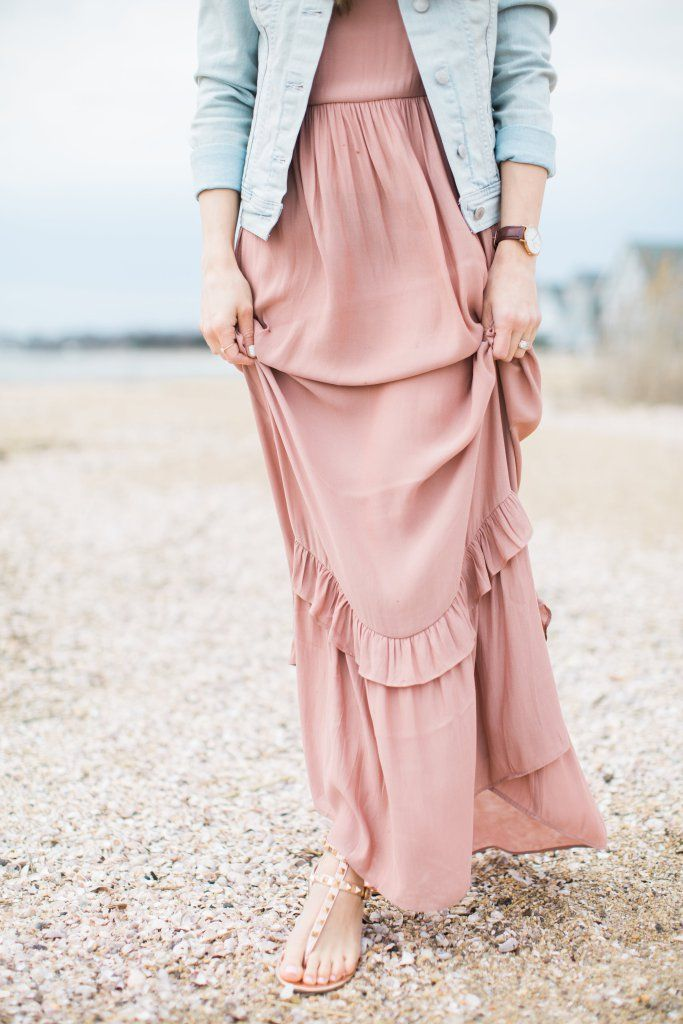 c2b997f6702 Ruffled maxi dress styled with casual studded sandals and a denim jacket