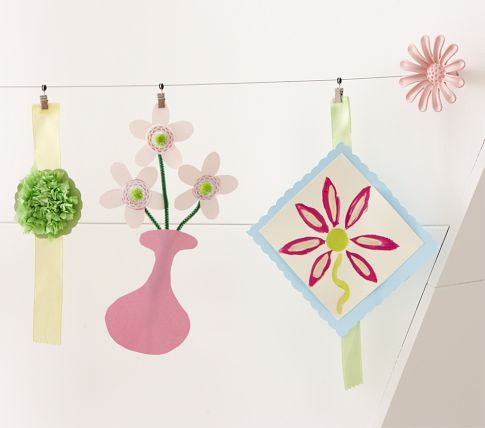Flower Art Cables... Stretch for 10 feet and allow you to decoratively display artwork... also comes in a Star version for boy's room... from Pottery Barn.