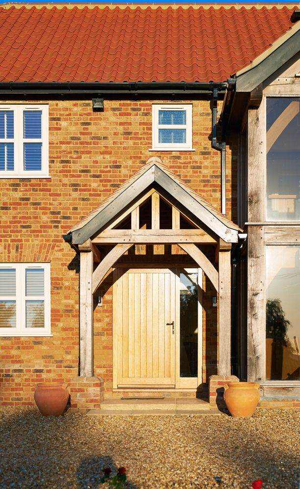 A timber frame porch welcomes you into the house. | Oak ...