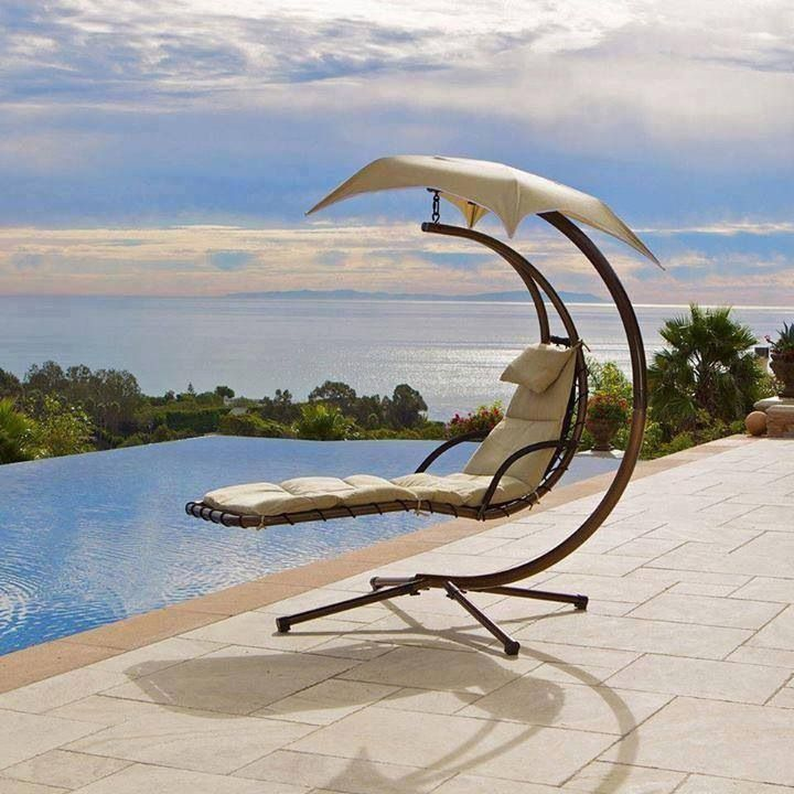 Swinging poolside lounger with curved cover. Stunning design